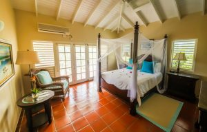 master bedroom with view and ensuite bath